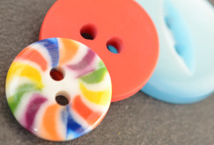 Three buttonsnext to each other close up in bright colours