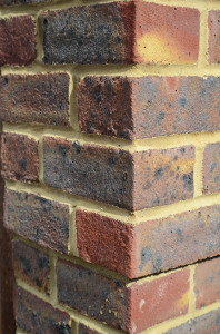 Brickwork on the side of a house seen from the corner
