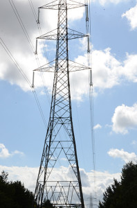 An electricity pylon seen almots overhead with a second small pylon in the distance
