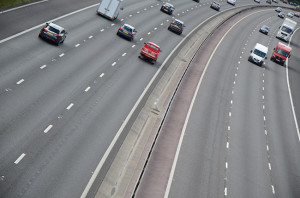 The M3 motorway seen at an angle so it curves away to the top right
