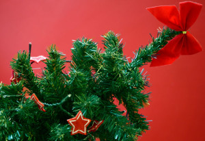 Artifical Xmas tree with red stars against a red background